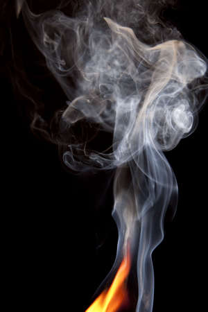 Close up of orange flame and large puff of smoke photo