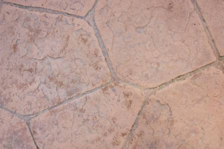 Concrete stained and stamped with stone texture