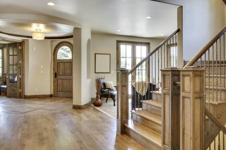 View of homes foyer and entrance with wood floors photo