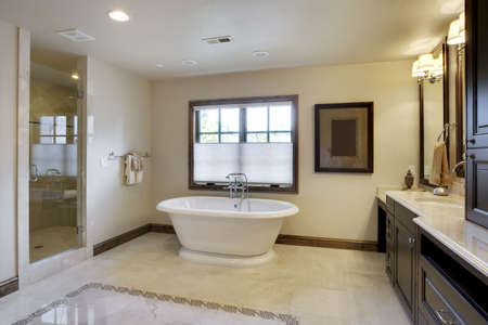 bathroom tile: Angled view of bathroom with tub and cabinetry
