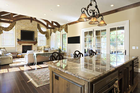 countertop: Large kitchen with view into adjoining rooms