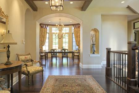 traditional living room: Grand foyer with area rug and view to dining room