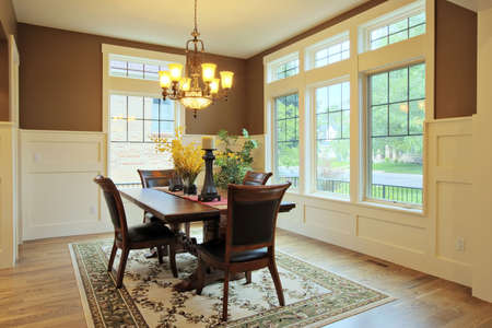 Large dining room with wood floors and area rug Stock Photo - 5317283