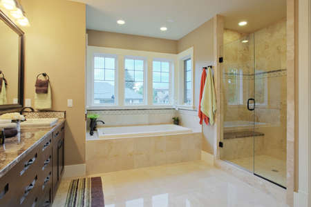 bathroom tile: Luxury bathroom with granite countertops and flooring