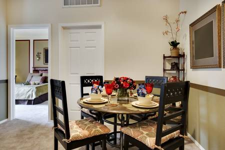 Dining table next to kitchen area Stock Photo - 5313612