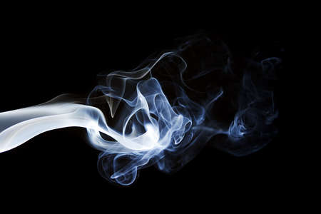 Blue gray smoke flowing horizontally