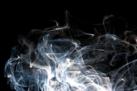 wisps: Wide wisps of smoke rising on black background Stock Photo