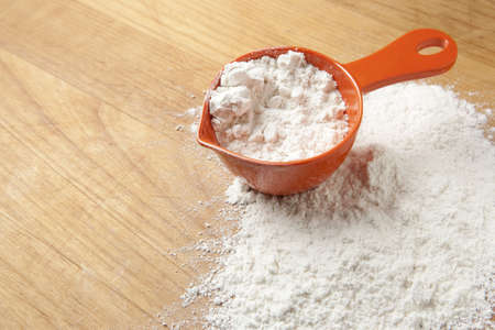 cup: Measuring Cup with Flour