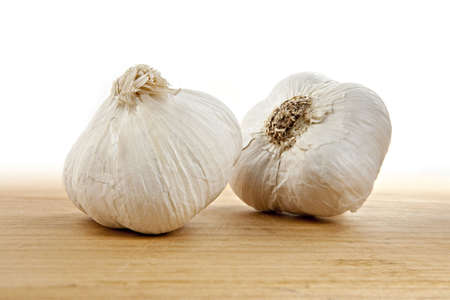 aftertaste: Garlic Bulbs on Cutting Board