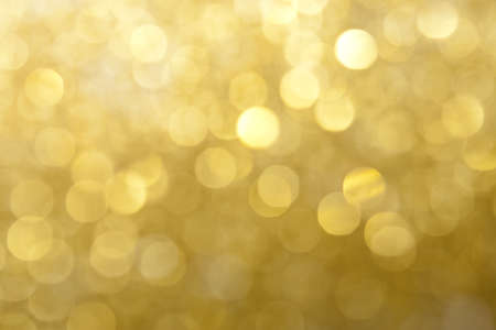 Gold and Yellow Sparkling Lights Background