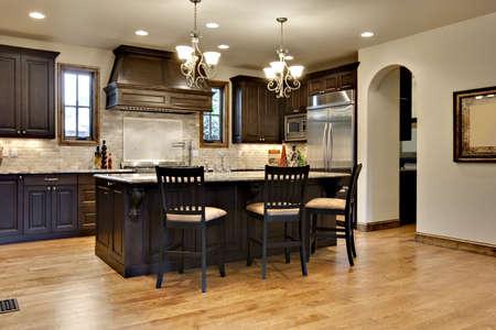 Dark Wood Kitchen with Granite Counters photo