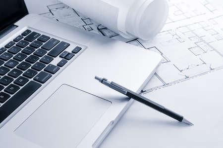 Laptop with Blueprints and Mechanical Pencil Archivio Fotografico