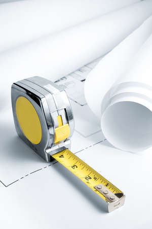 architect tools: Blue Prints with Measuring Tape Stock Photo