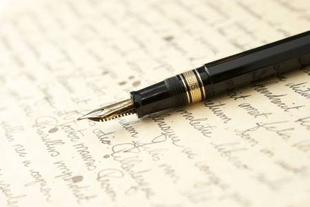 Gold Pen with Letter and Writing