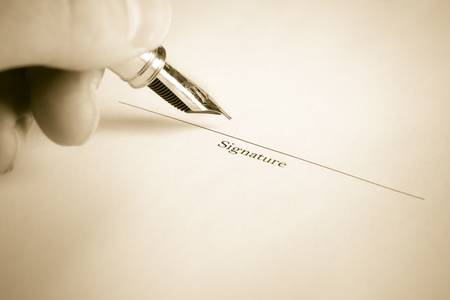 Left Hand Signing Name with Fountain Pen Stock Photo - 6134925