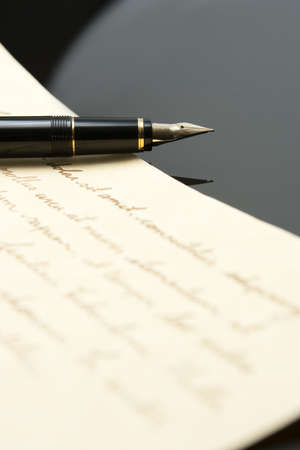 nib: Fountain Pen and Letter with extreme shallow depth of field. Focus on very end of nib on pen.