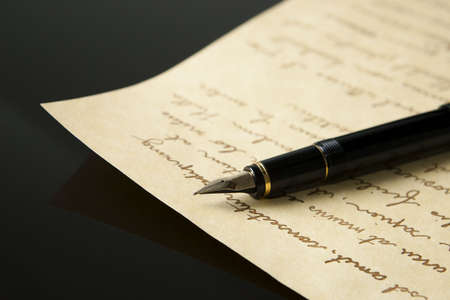 Fountain Pen and Letter with extreme shallow depth of field. Focus on very end of nib on pen. Stock Photo - 6274951