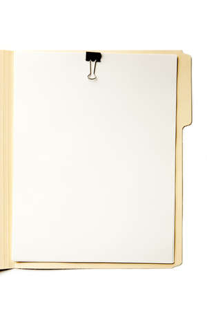 Manilla File Folder on White. Stack of paper with clip. Focus on paper surface.