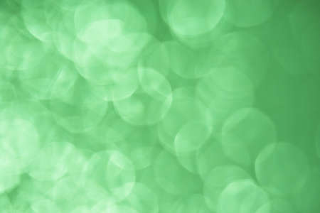 Large Green Defocused background with overlapping sparkling circles photo