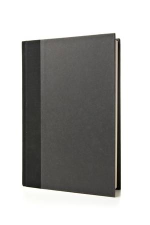 흰색 배경에 서있는 검은 책. 스튜디오 조명 및 격리입니다. 스톡 콘텐츠
