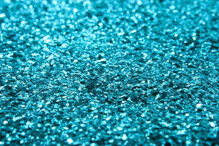 metallic: Selective focus with clear detail on glitter slightly below middle of frame.