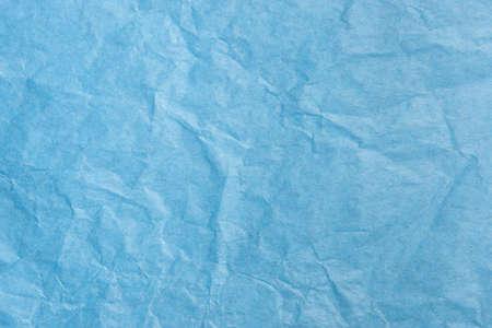 青い画用紙のテクスチャのクローズ アップ。表面全体に均等に焦点を当てます。
