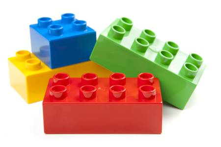 building blocks: Bright Color Building Blocks Isolated on White. Focus on near edge of bricks with selective focus