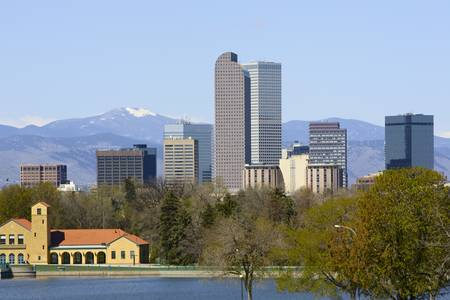 Denver Skyline with Mountain Backdrop. Focus on skyscrapers.