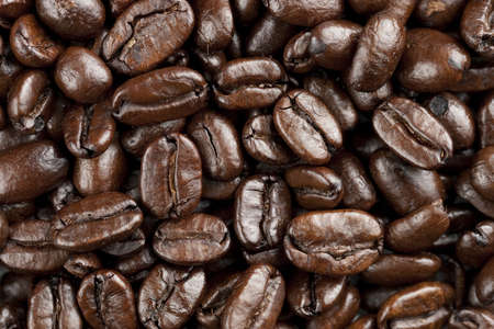 Coffee beans on white background. Heap out from edge for border design element Archivio Fotografico