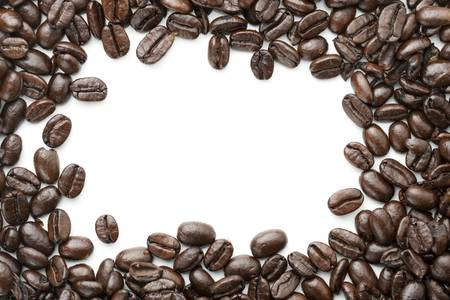Coffee beans on white background. Border layout for border design element. Copy space on pure white in center