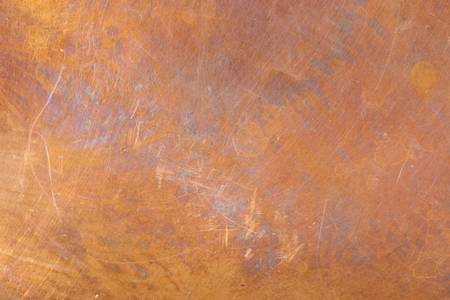 oxidized: Heavily worn copper texture surface. Even focus across surface.