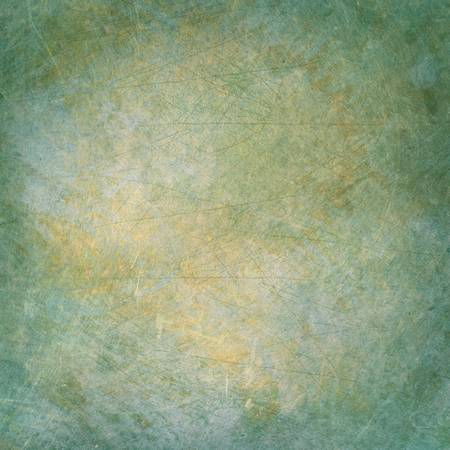 textured backgrounds: Grunge metal surface with scratches and stain spots. Green and yellow with soft vignette.