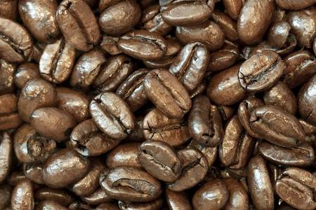 Coffee beans background with focus across entire top layer of beans. Archivio Fotografico