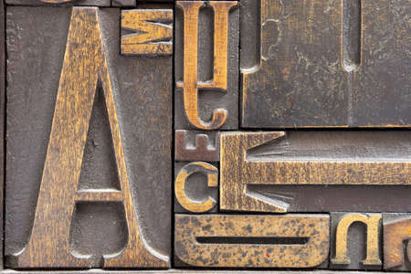Antique printing block letters. Focus across entire surface.