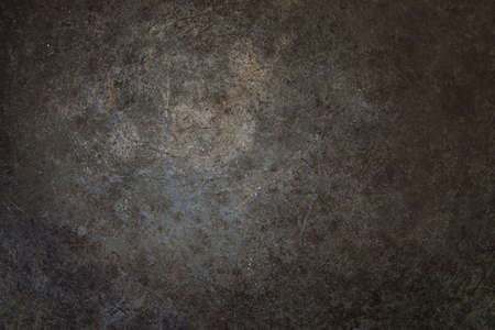 Grunge rust metal surface with vignette.