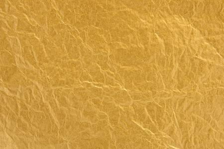 ゴールド箔全体の表面の間でフォーカスを持つテクスチャ