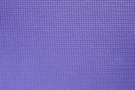 Paarse yoga mat textuur met focus over gehele oppervlak
