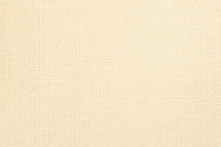点線のディンプル テクスチャと黄色い紙の表面。