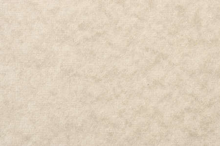 黄色と茶色の背景紙のテクスチャです。細かい繊維が見える