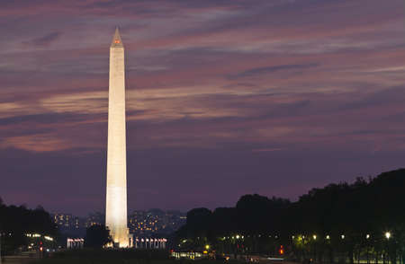 Washington Monument at Sunset. Focus on monument against purple and pink sky.
