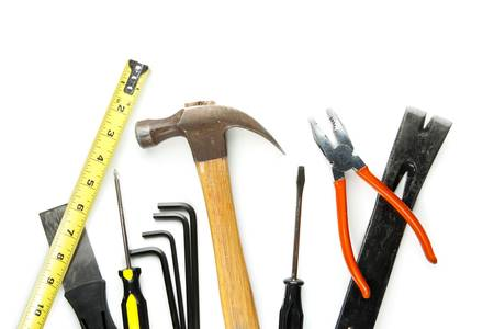 Many construction tools isolated on white background with soft shadows
