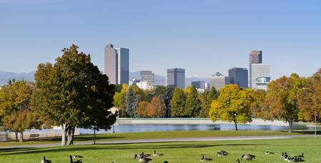 Denver Skyline in Autumn with park and lake in view photo