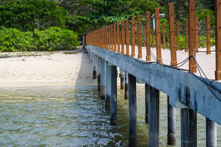 wooden railings: Wooden railings on the pier on the beach Stock Photo