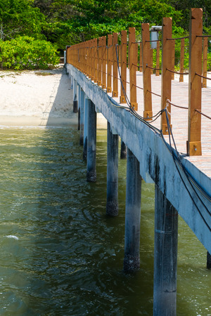 orenge: Colored photo of pier columns on the beach Stock Photo