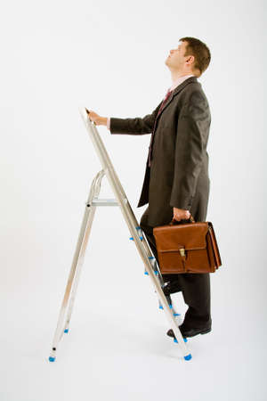 Business man with ladder on a white background photo