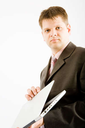 Young business man with laptop computer on white background photo