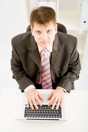 Business man use the laptop computer photo