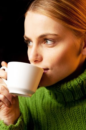 beautiful young woman drinking cappuccino photo