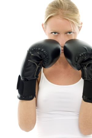 portrait of a young caucasian woman who does kick boxing with boxing gloves Stock Photo