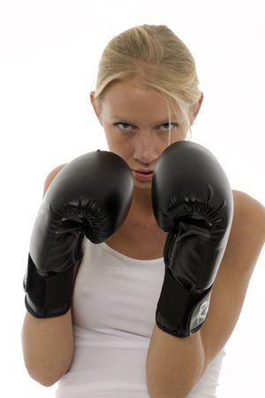 only one woman: portrait of a young caucasian woman who does kick boxing with boxing gloves Stock Photo